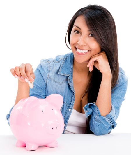 Casual woman saving money in a piggybank - isolated over white background
