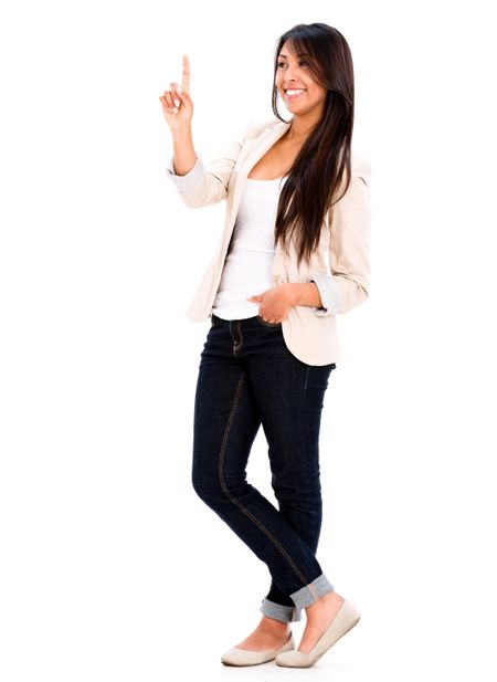 Happy woman pointing up - isolated over a white background