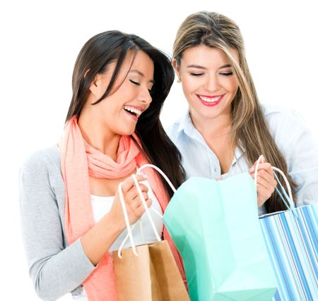Happy shopping women looking at purchases - isolate dover white background