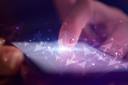 Finger touching phone with human network concept and dark background