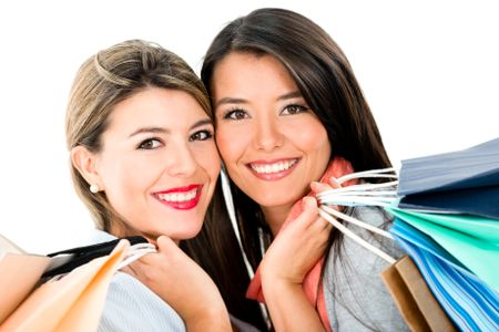 Happy shopping women holding bags - isolated over white background