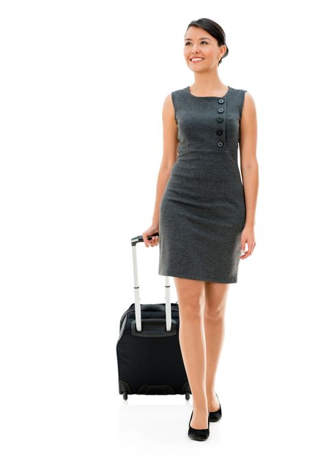 Successful woman on a business trip - isolated over white background