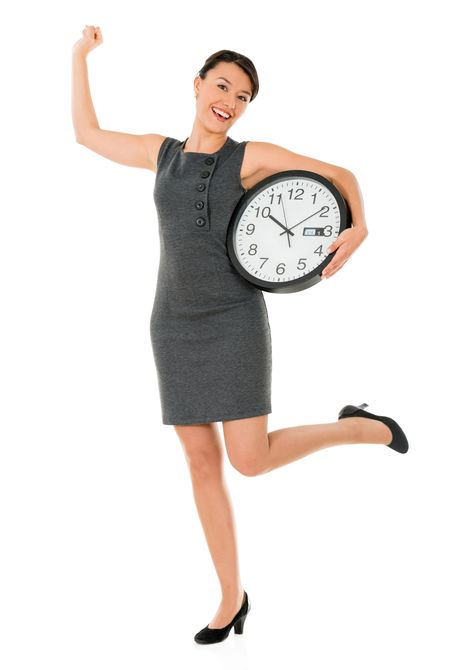 Excited business woman on time with a clock - isolated over white