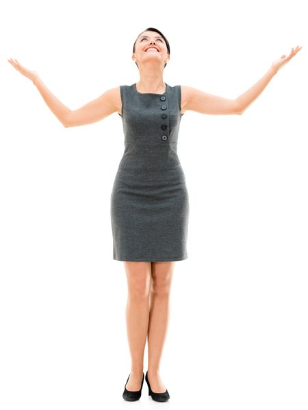 Business woman with arms open looking up - isolated over white
