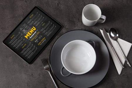 Empty plate and tableware with online order menu