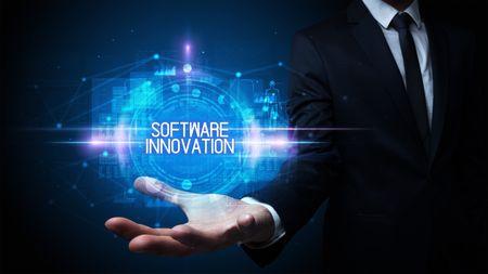 Man hand holding SOFTWARE INNOVATION inscription, technology concept