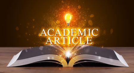 ACADEMIC ARTICLE inscription coming out from an open book, educational concept