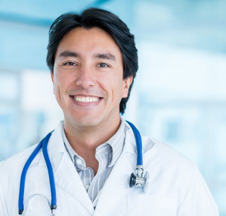 Portrait of a male doctor smiling at the hospital