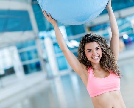 Woman exercising with a Pilates ball at the gym