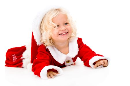 Portrait of a very happy female Santa smiling - isolated over white