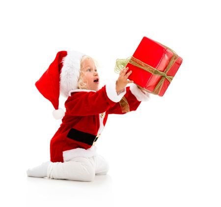 Girl dressed as Santa giving a Christmass gift - isolated over white