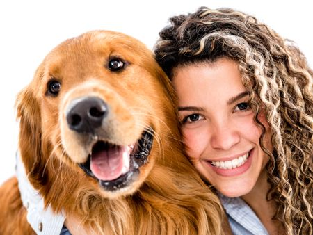 Happy woman with a cute dog - isolated over white background