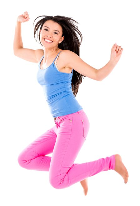 Happy woman jumping and smiling - isolated over white background