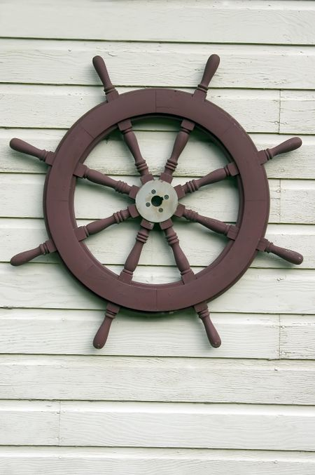 Riverboat steering wheel on exterior wall