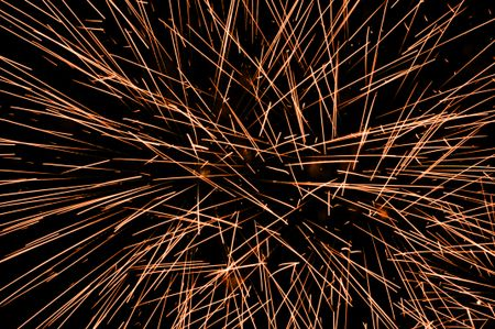 Helter-skelter light trails from one or two bursts of fireworks