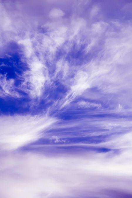Wispy cirrus clouds in a blue sky