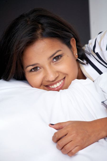 beautiful woman portrait smiling in her bed