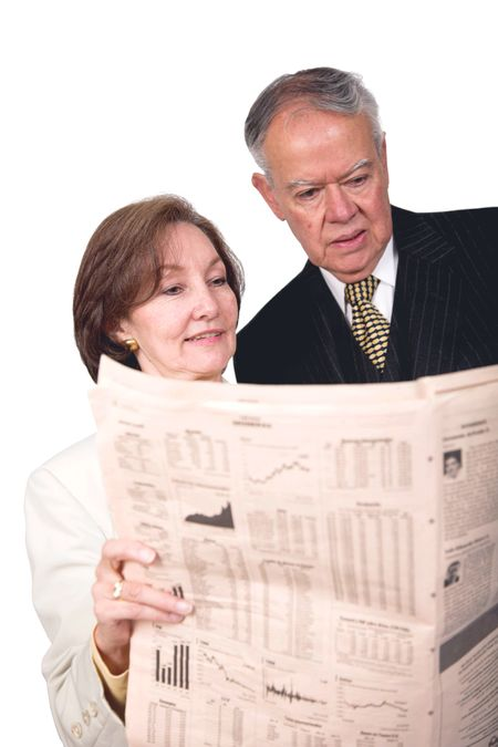 business partners reading financial paper over white