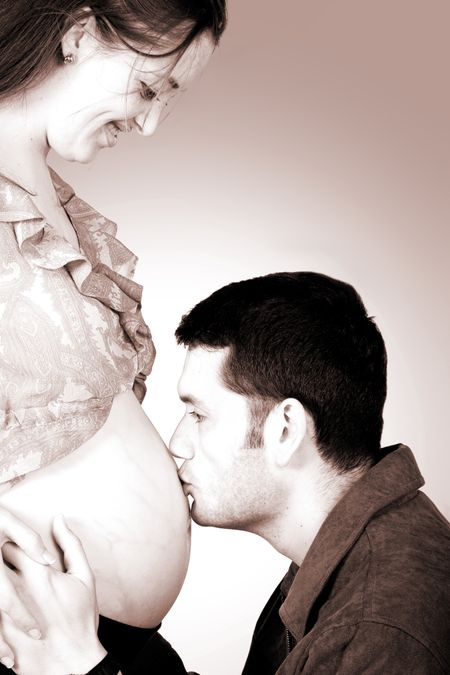 dad kissing mums belly - including clipping path to easily change the background