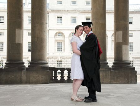 graduate and his partner at a university
