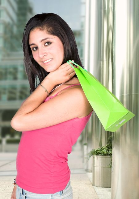 casual girl in pink shopping in a mall