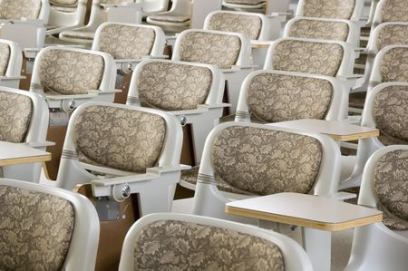 Padded backs of seats in college lecture hall