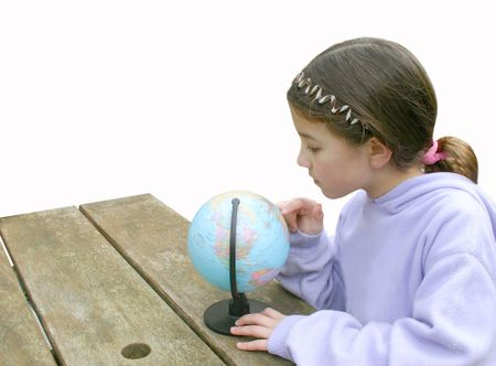 beautiful little girl exploring a globe