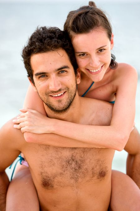 happy couple at the beach during vacation