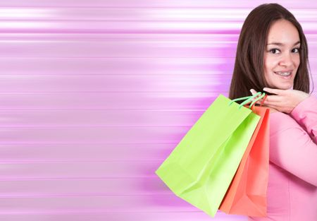 beautiful girl shopping in pink - photo with space for writing