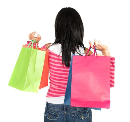 girl in pink holding bags over white