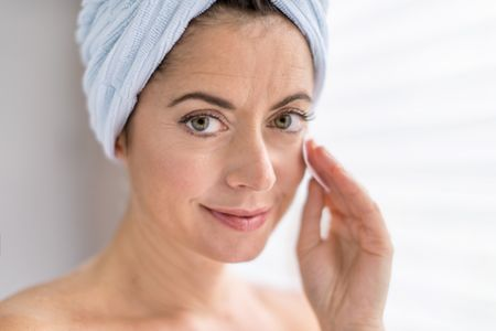 attractive woman in her forties removing make up