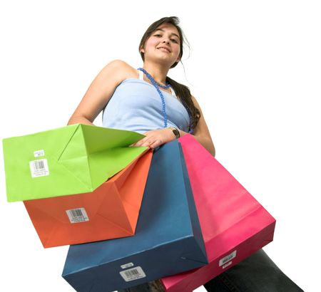 beautiful teenager with shopping bags over white taken from a low angle