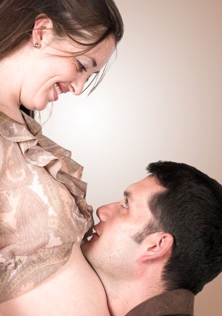 couple - girl pregnant over brown
