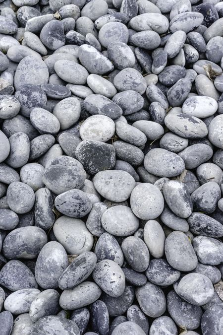 Background of smooth rounded stones outdoors