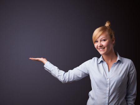 Businesswoman presenting empty space