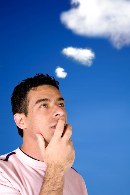 casual pensive man with the sky and clouds in the background