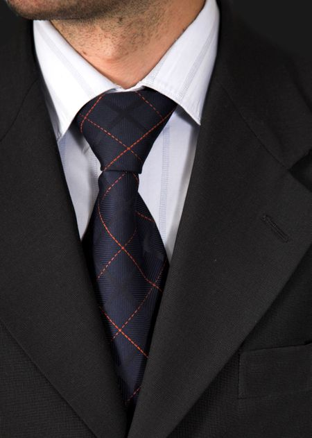 business suit over a black background , good contrast between the colours