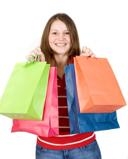 beautiful girl with shopping bags over white