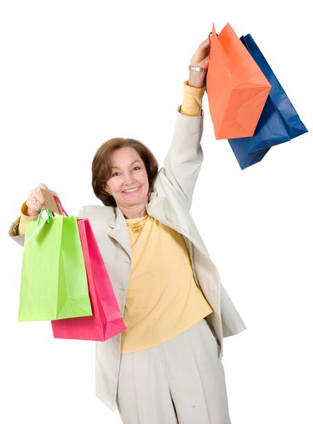 business woman very happy with her shopping bags over a white background