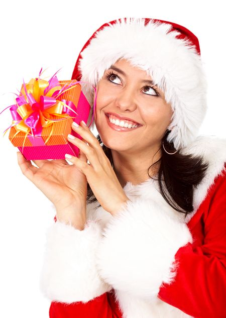 female santa holding a christmas gift smiling