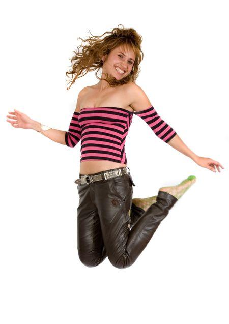 girl jumping full of joy over a white background
