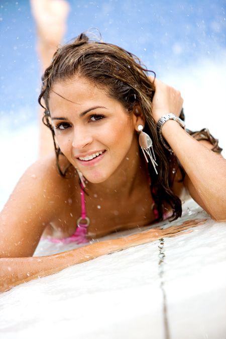 beautiful fashion woman by a swimming pool