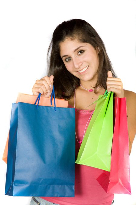 beautiful teenager with shopping bags over white