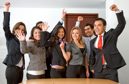 business team in an office full of success looking happy