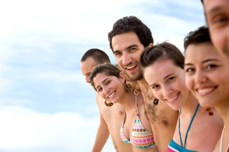 happy group of friends together in swimwear
