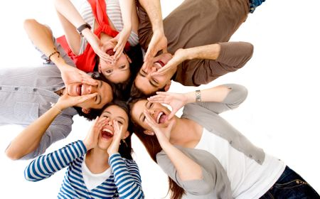 Friends shouting on the floor with their heads together isolated over a white background