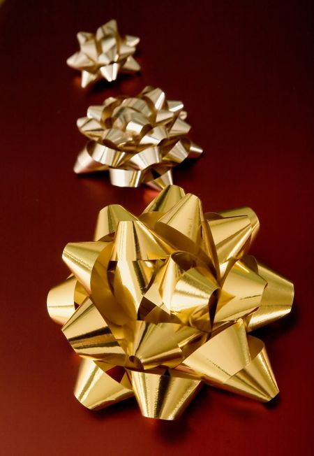golden birthday or christmas ribbons on red gifts