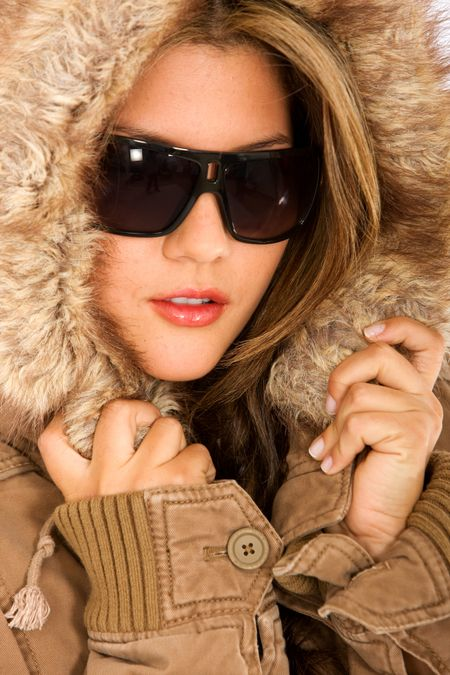 beautiful woman wearing winter clothes and sunglasses