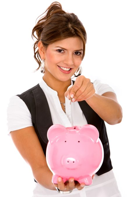 casual woman saving money in a piggybank - isolated on white