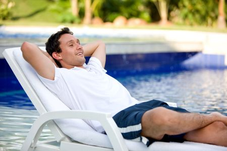 casual man relaxing on his holiday home
